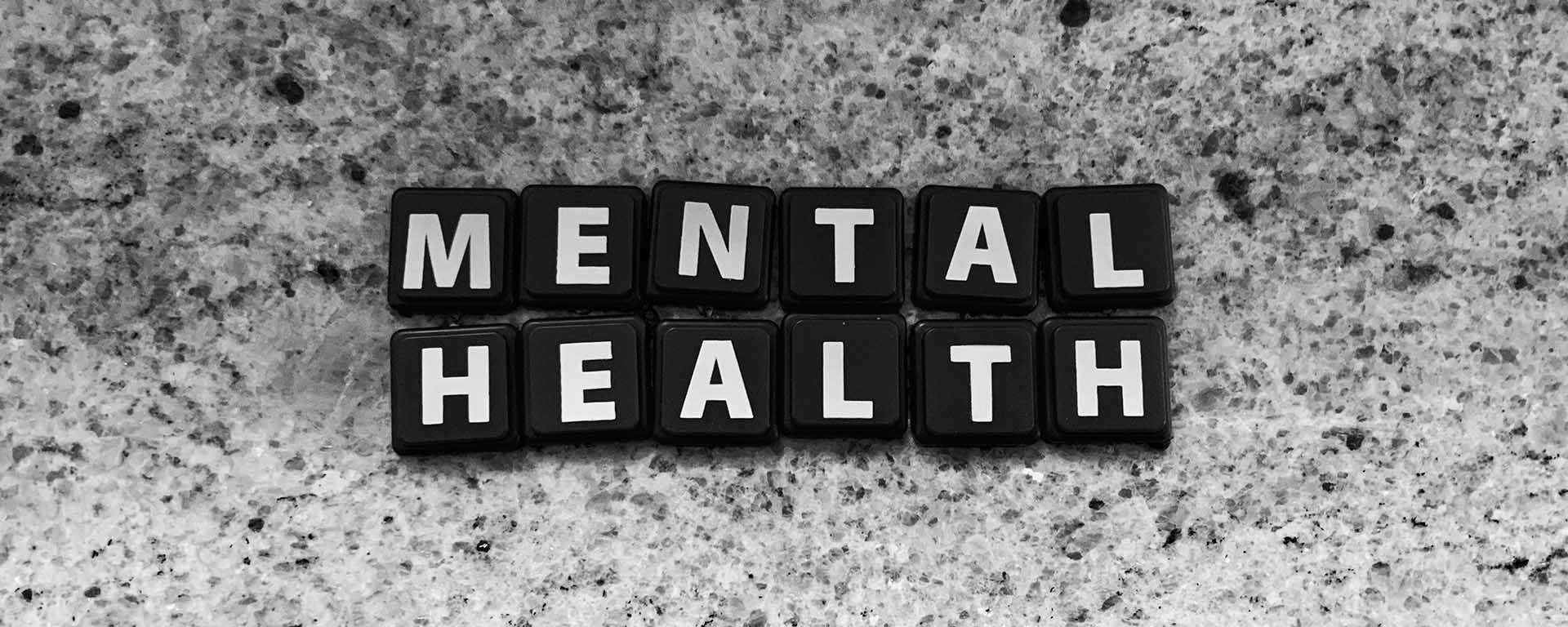 Letter tiles spell out: Mental health