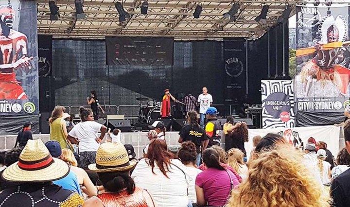 A crowd watches an Aboriginal band at the Yabun Festival