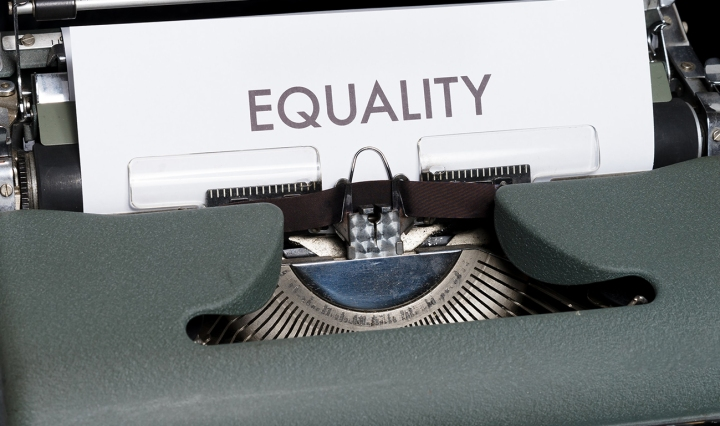 Typewriter with a piece of paper that says: EQUALITY