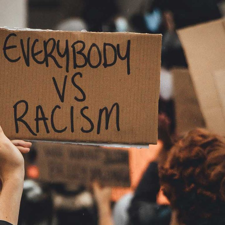 """Protest sign reads: """"Everybody vs Racism"""