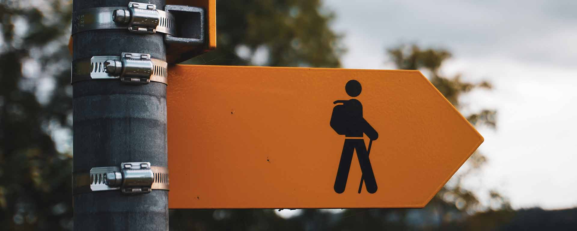 Street sign showing a stick figure person of a hiker