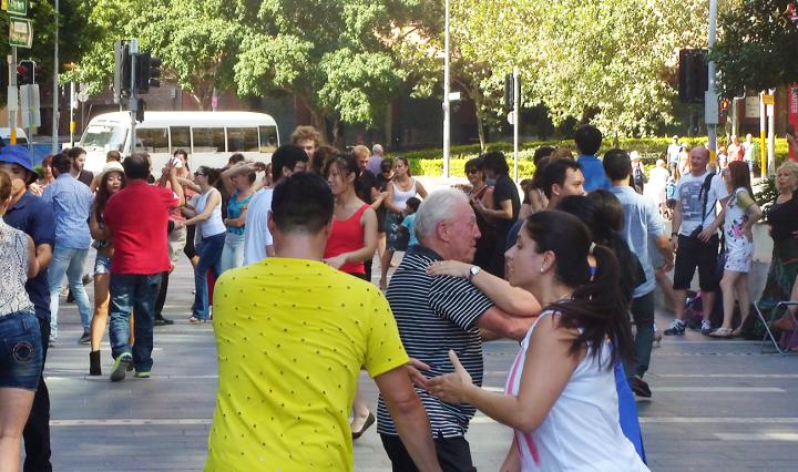 People dance outdoors
