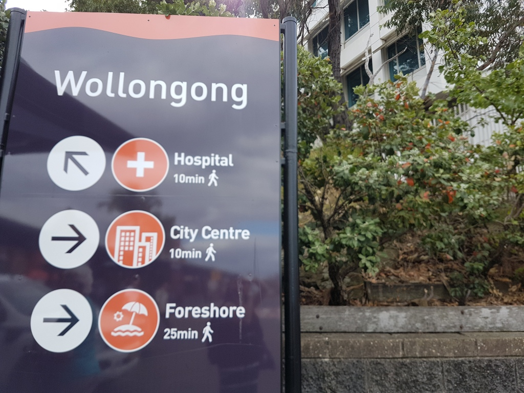 Wollongong sign shows the directions to the hospital, city centre and foreshore
