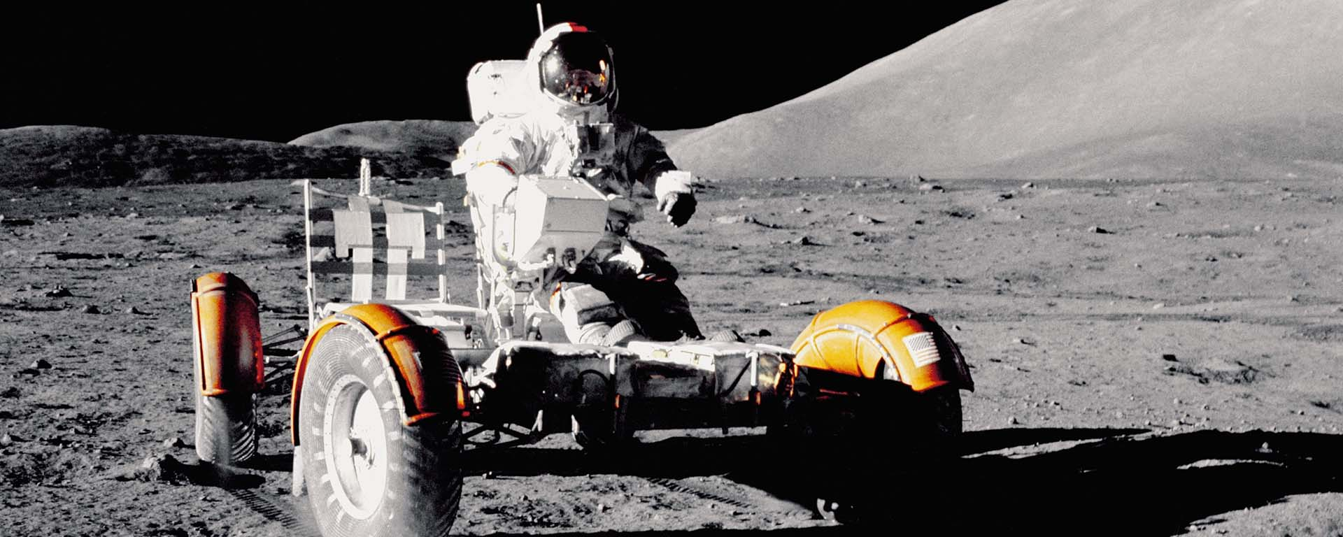 Astronaut riding a vehicle in space