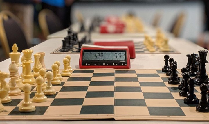 Chess board and timer on a table