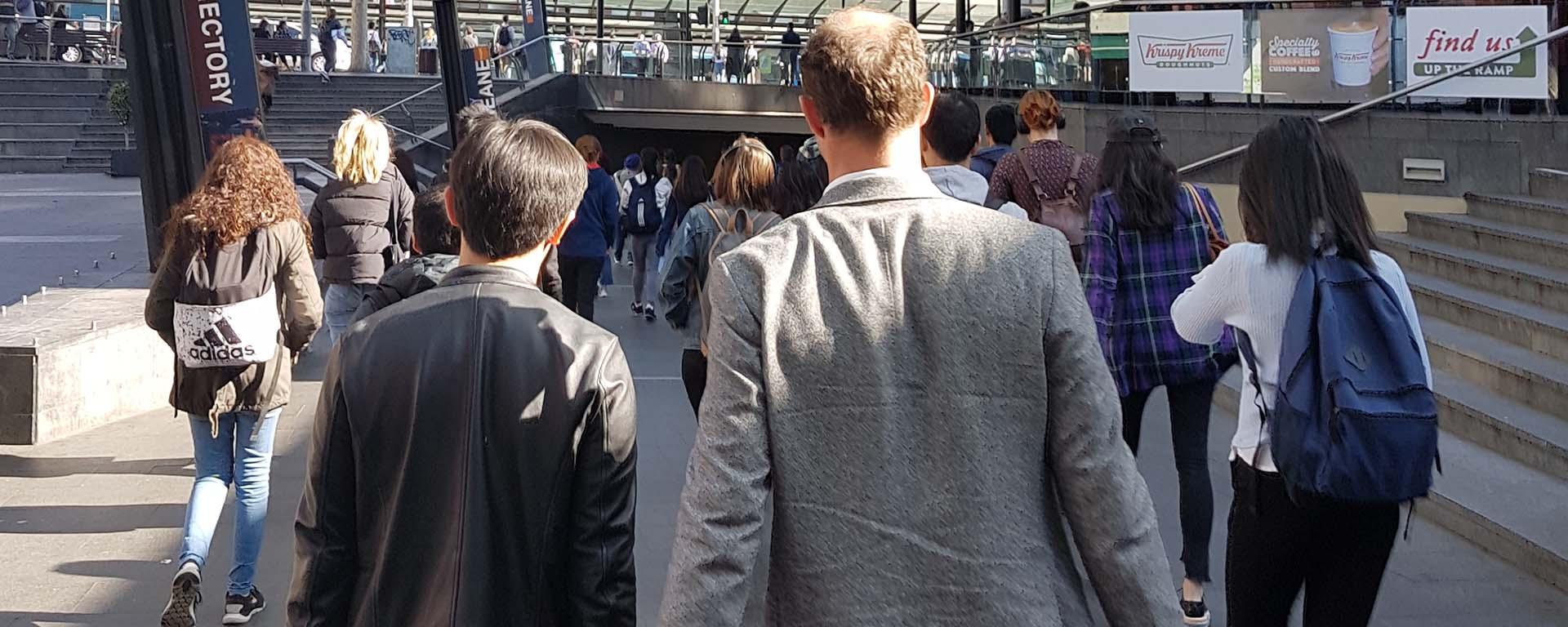 People seen walking, from the back, in Sydney
