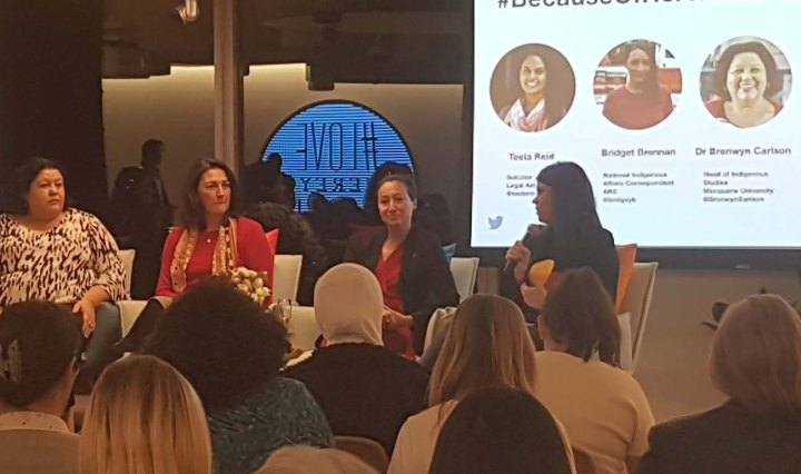Aboriginal women speakers sit up front of an audience at Twitter Australia headquarters