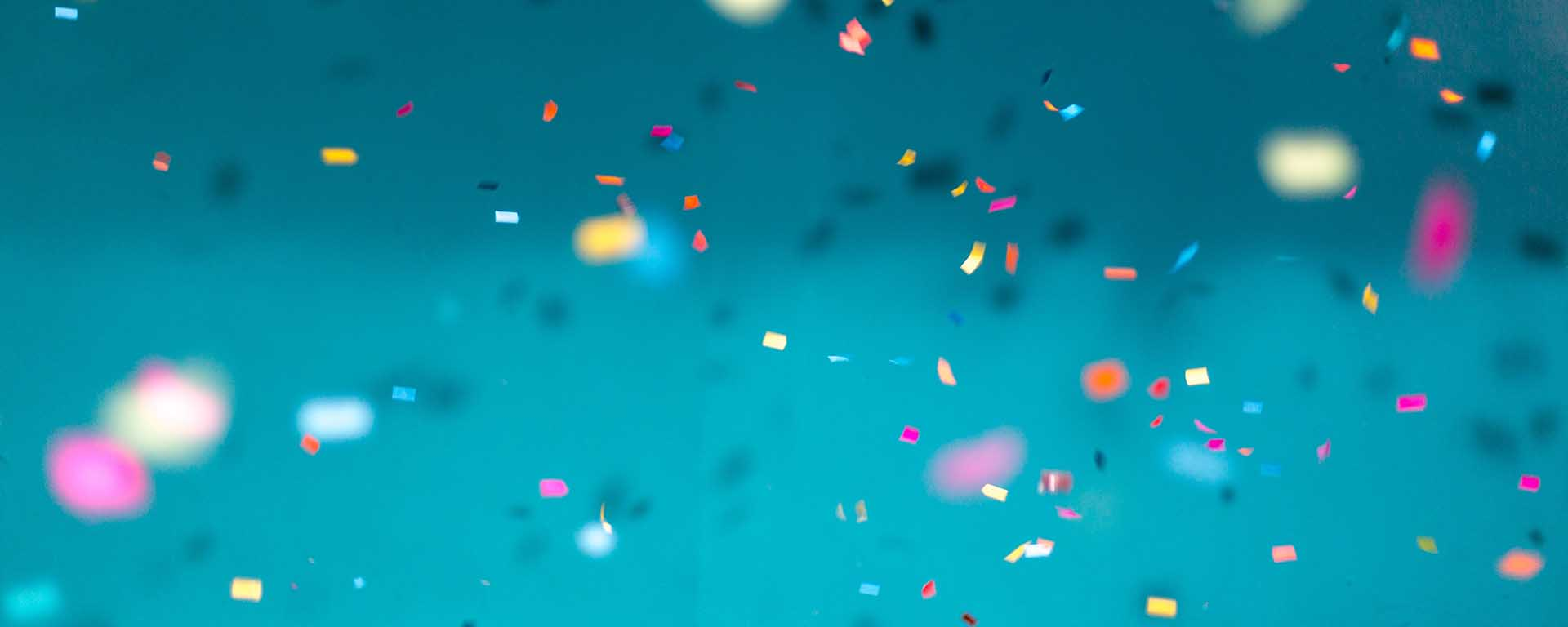Confetti against a blue background