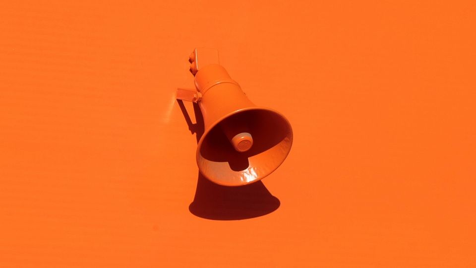 Orange wall with orange megaphone