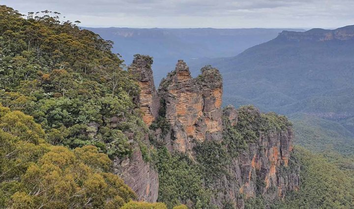 Top of the Blue Mountains. Large mountains with lush green trees, and a blue haze over the mountains in the horizon