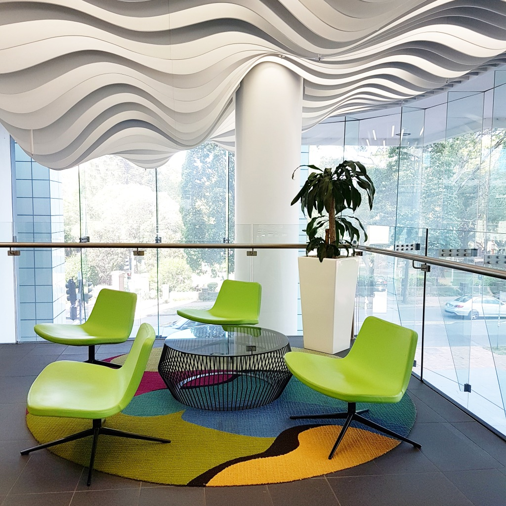 A light-filled office with bright lime-coloured chairs