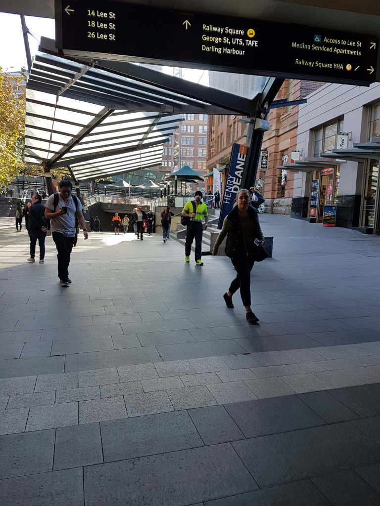 People walking at Henry Deane Square, in Sydney