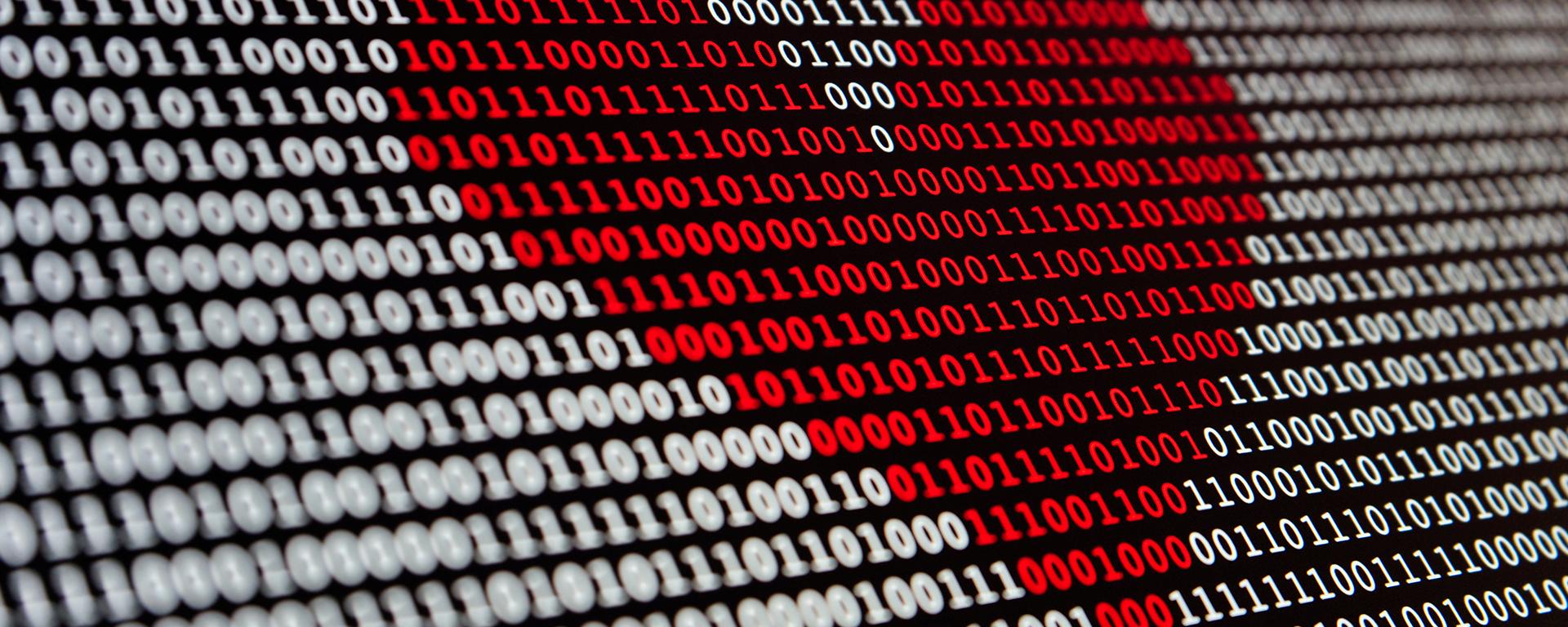 Red love heart over binary code