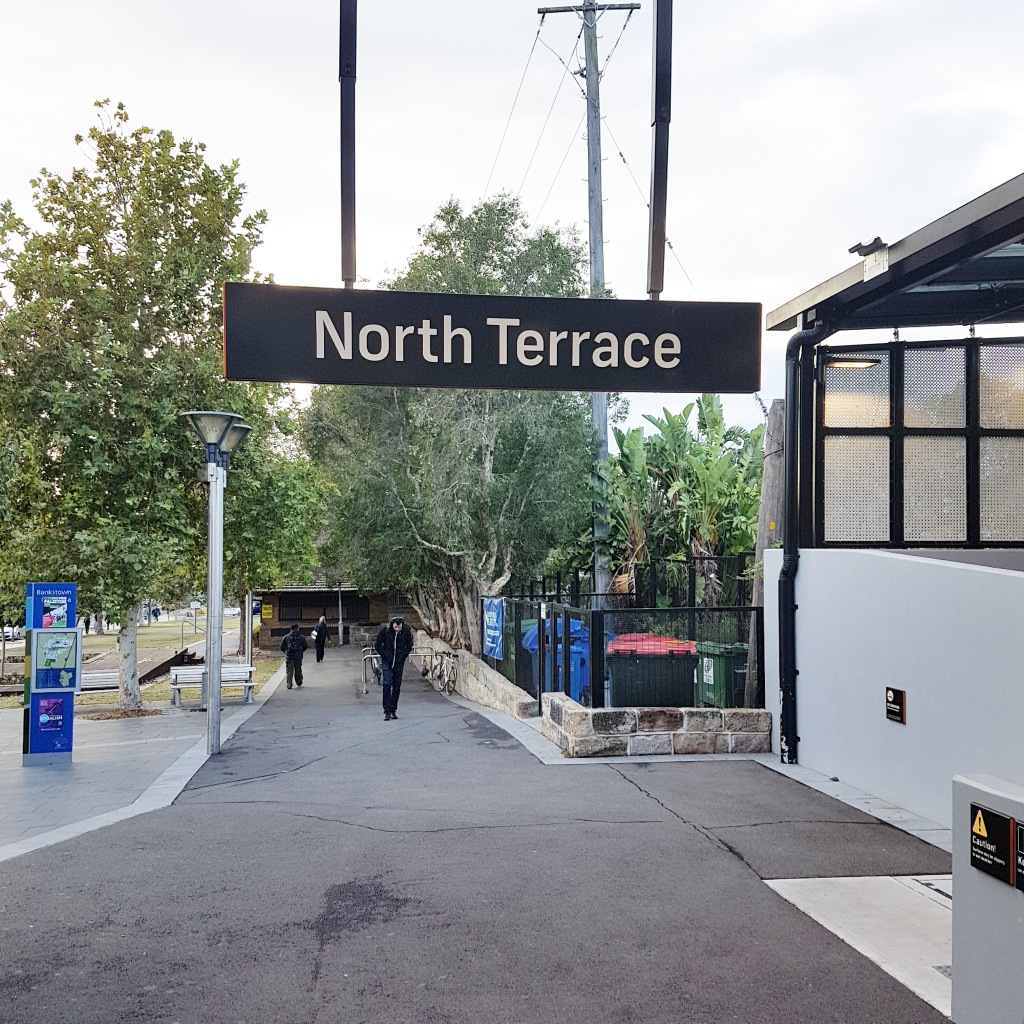 A person walks with their head down in North Terrace Bankstown train station