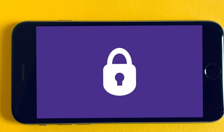 A mobile phone with a padlock symbol in the centre of the screen