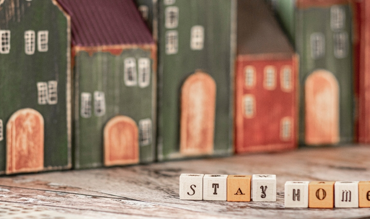 Drawings of houses with letter blocks that spell out: Stay home