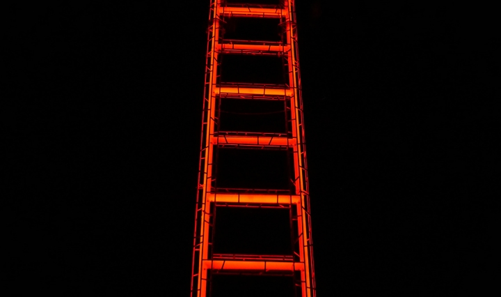 A neon ladder against a black background