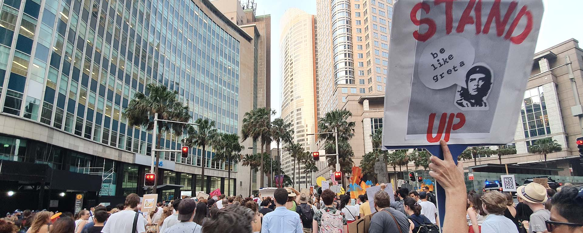 Crowd of protesters in Sydney. Sign with Che Guevara reads: Stand up. Be like Greta