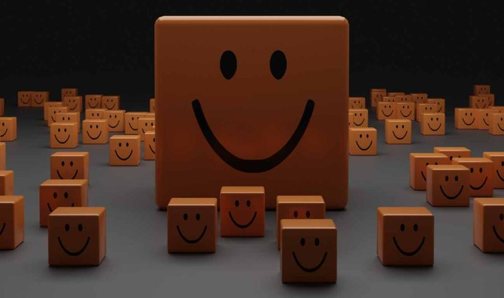 Many small blocks of wood, with one large wood rectangle in the centre. They all have a smiley face drawn on them